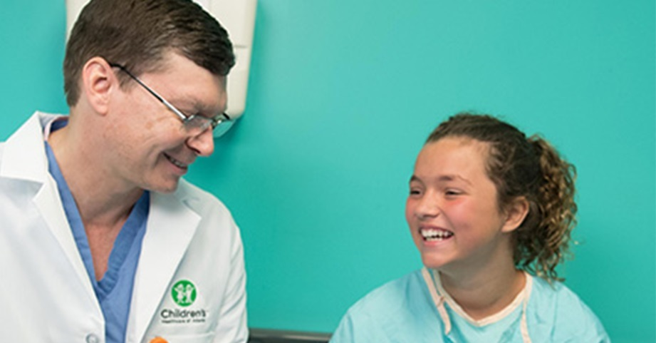 Dr. Schrader visits a hip patient before surgery.