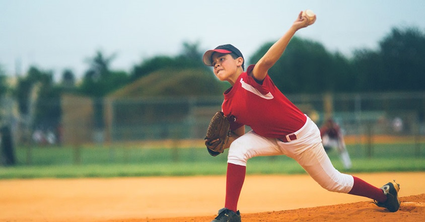 Boy pitching from baseball mound