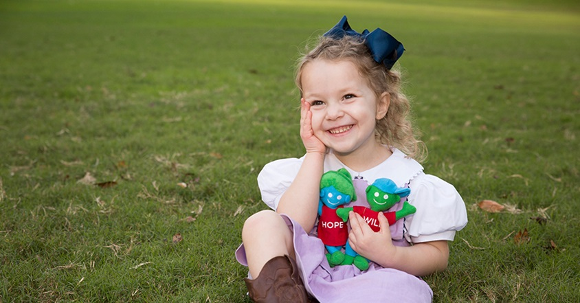 Pediatric brain cancer patient smiling with hope and will