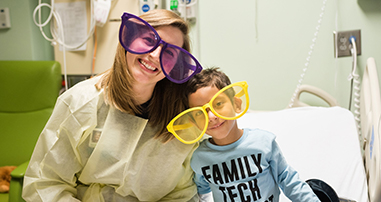 nurse and pediatric patient smile with funny glasses