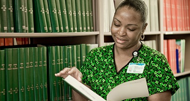 Clinical staff member in library