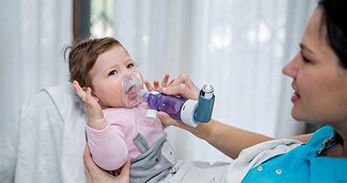 Baby receiving breathing treatment for asthma