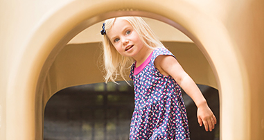 girl on playground at marcus autism center preschool