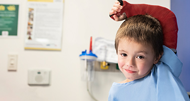 boy receiving pediatric care for broken arm