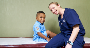 Dr. Flanagan with pediatric patient with hip conditions