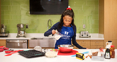 Pediatric sickle cell teen patient learning to cook