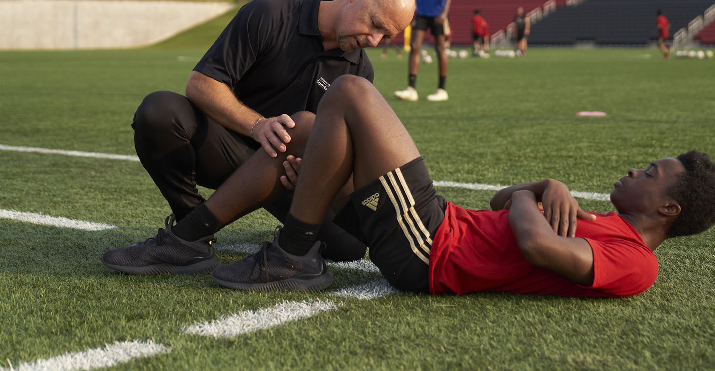 Children's athletic trainer assesses Atlanta United Academy player's injury