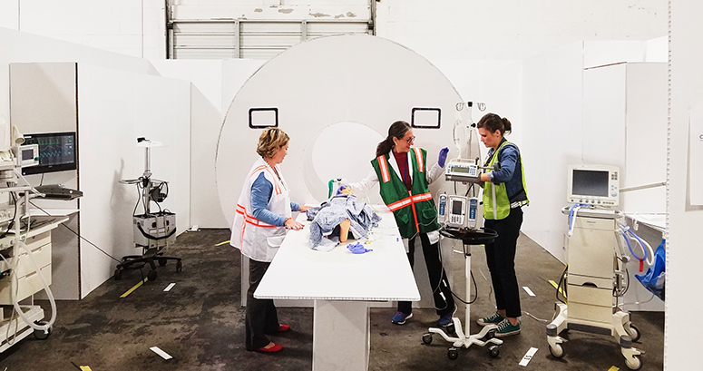 radiology and sedation staff run through MRI simulation in cardboard city