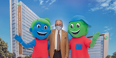 Arthur M. Blank with Children's mascots Hope and Will at hospital naming event