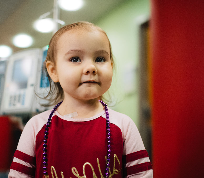 cancer patient showing her beads at Children's hospital