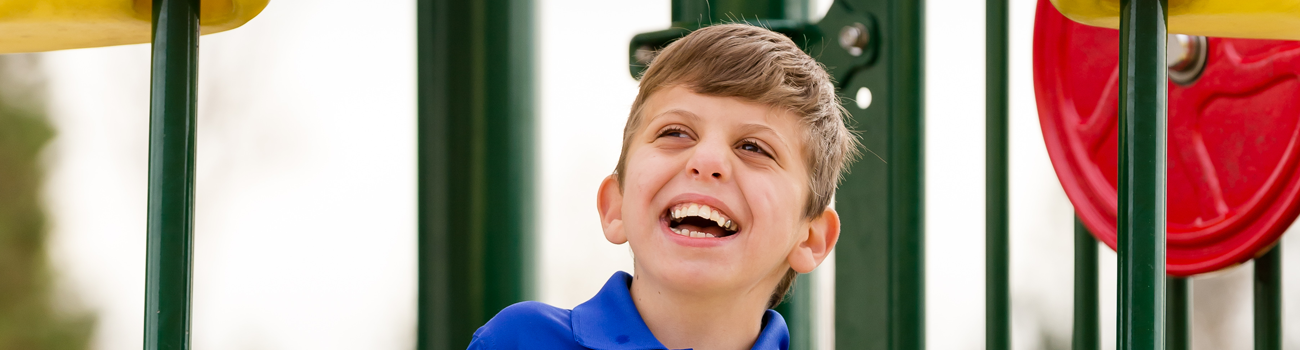 boy-smiling-on-playground
