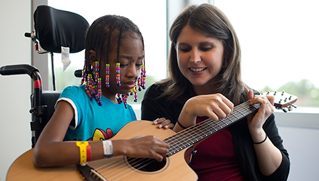 Inpatient Rehab girl with guitar for music therapy day